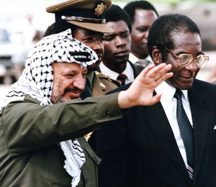 Mugabe also met the Chairman of the Palestine Liberation Organization [PLO] Yasser Arafat, who reportedly praised the leader for his solidarity towards the Palestinian people. [File: AP Photo]