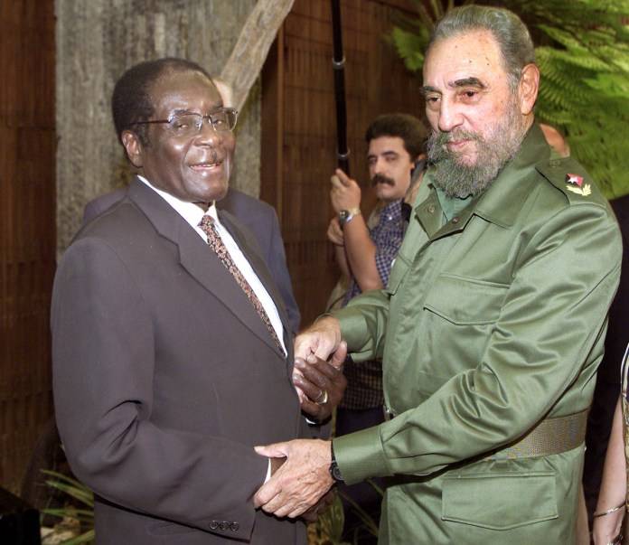 During his time in power, Mugabe met Cuba's President Fidel Castro several times. He praised his government for having trained thousands of Zimbabwean doctors and teachers. [File:Jose Goitia/AP Photo]