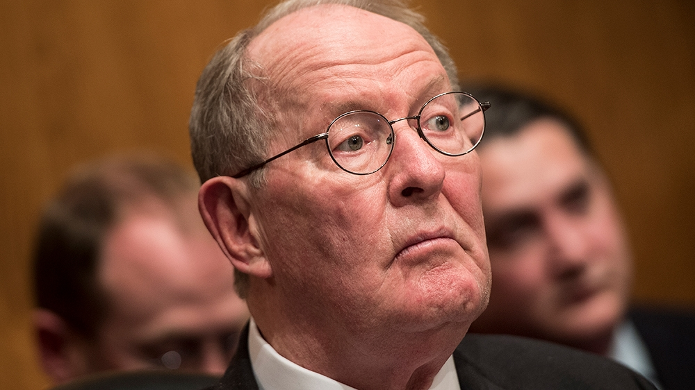 Committee chairman Senator Lamar Alexander (R-TN) listens while  Betsy DeVos speaks during her confirmation hearing for Secretary of Education before the Senate Health, Education, Labor, and Pensions
