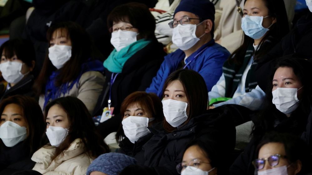 Spectators wearing masks to prevent contacting to a new coronavirus attend Four Continents Figure Skating Championships 2020 in Seoul
