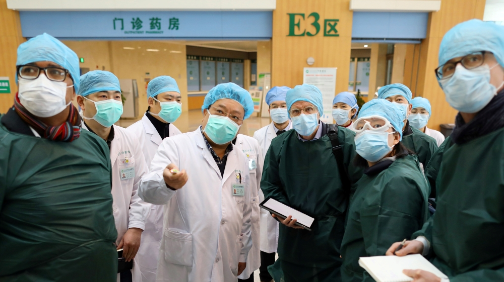 Experts from China and the World Health Organization (WHO) joint team wearing face masks visit the Wuhan Tongji Hospital in Wuhan, the epicentre of the novel coronavirus outbreak, in Hubei province, C