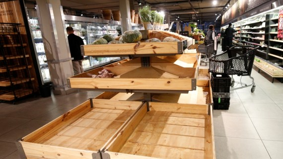 A supermarkets vegetable racks are empty as people stock up on food after the government announced measures to curb coronavirus infections in Hillcrest