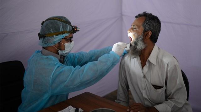 Bangladesh coronavirus test kit [Mahmud Hossain Opu/Al Jazeera]
