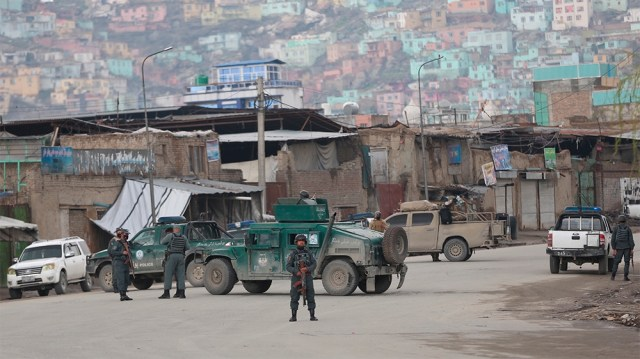 Afghan police arrive at the site of an attack in Kabul, Afghanistan, Wednesday, March 25, 2020. Gunmen stormed a religious gathering of Afghanistan's minority Sikhs in their place of worship in the he
