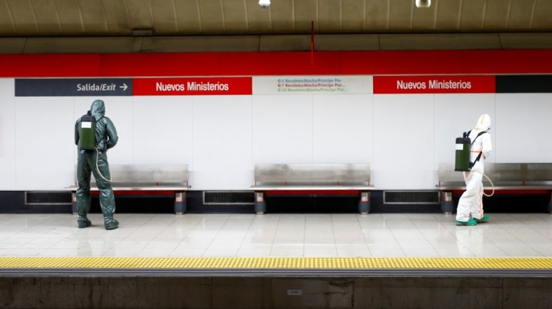 Military Emergency Unit members disinfect Nuevos Ministerios metro station during a partial lockdown as part of a 15-day state of emergency to combat the spr