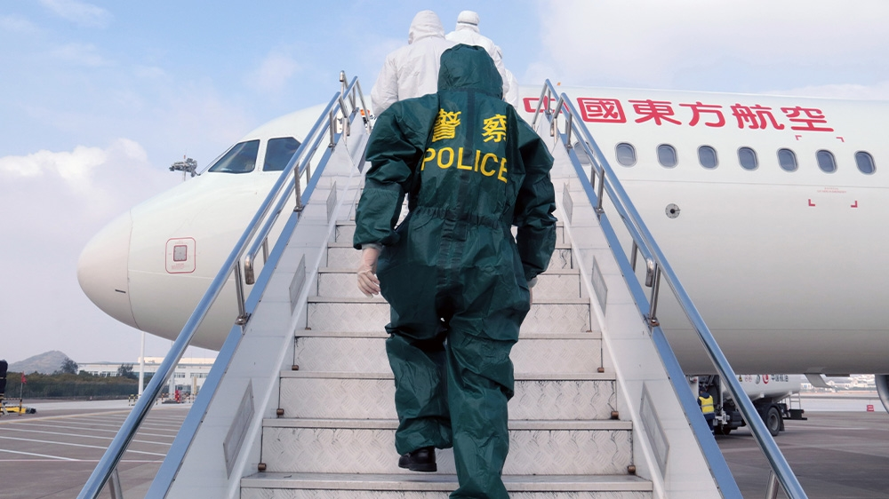 China worries about new coronavirus surge from infected arrivals ...