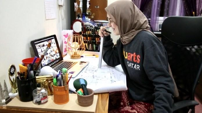 A student at VCUarts Qatar takes online classes via the Zoom platform. [File: Reem Selo/Al Jazeera]