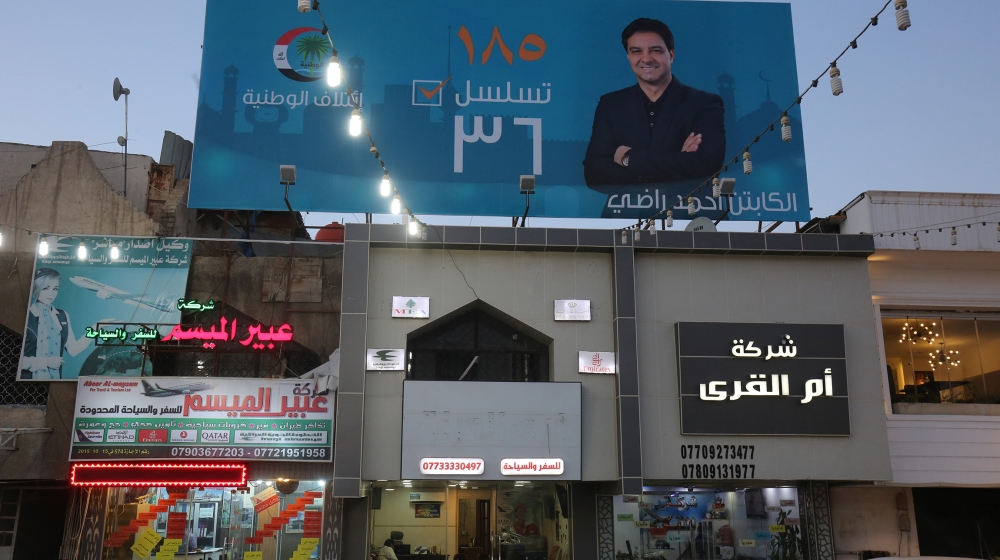 In this file photo taken on April 23, 2018 shows the campaign poster of Ahmed Radhi, a former Iraqi footballer, hanging in a street in Baghdad. Iraqi football legend Ahmed Radhi died on June 21, 2020