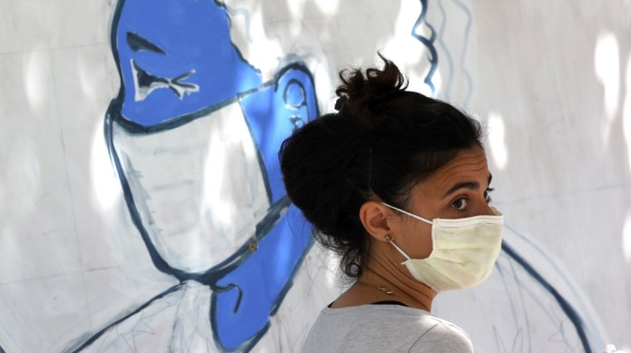 An Emergency room doctor paints a mural outside of Zuni restaurant to honor medical workers during coronavirus COVID-19 pandemic on June 22, 2020 in San Francisco, California. Doctors and medical work