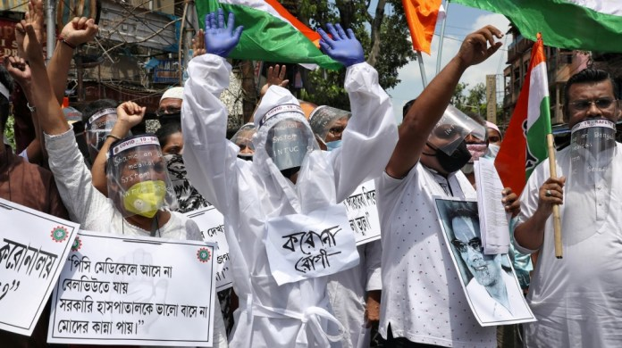 Demonstration demanding better treatment for people infected with COVID-19 in Kolkata