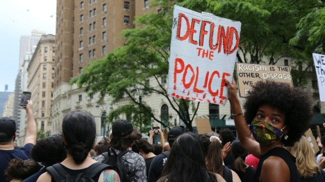 Defund the police AP photo