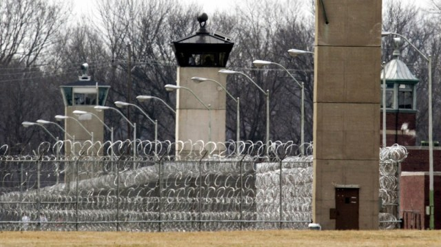 In this March 17, 2003 file photo, guard towers and razor wire ring the compound at the U.S. Penitentiary in Terre Haute, Ind., the site of the last federal execution. Democratic presidential candidat