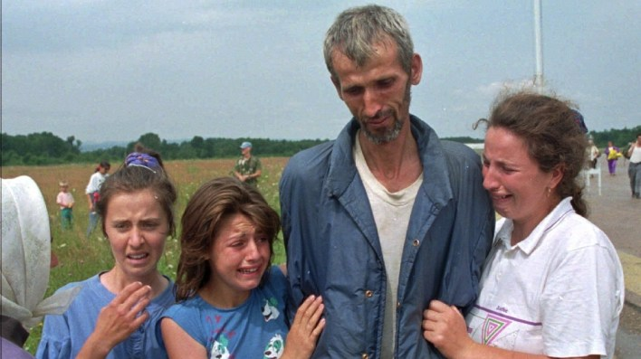 ISO Certificate FILE - In this Monday July 17, 1995 file photo, Bosnian refugees cry as their father and husband arrives at the U.N. air base in Tuzla, Bosnia, after he survived the death march of six days from Srebr