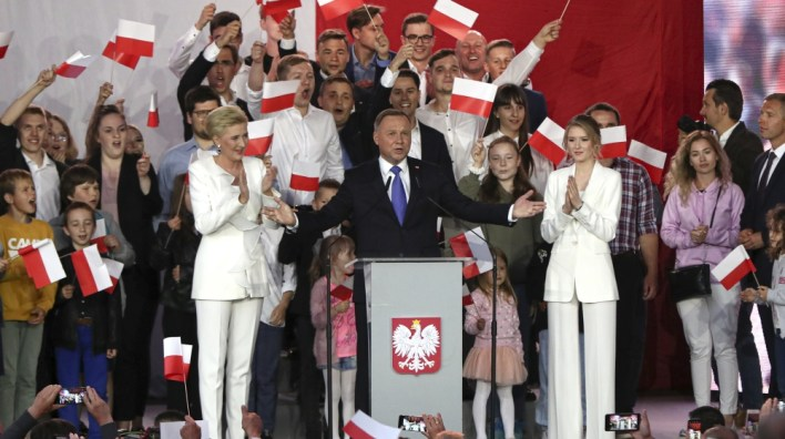 ISO Certificate Incumbent President Andrzej Duda, center, gestures next to his wife Agata Kornhauser-Duda and daughter Kinga, right while speaking to supporters in Pultusk, Poland, Sunday, July 12, 2020. Conservative