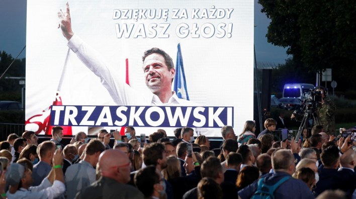 ISO Certificate Supporters of Warsaw Mayor Rafal Trzaskowski, presidential candidate of the main opposition Civic Platform (PO) party, react after the announcement of the first exit poll results on the second round o