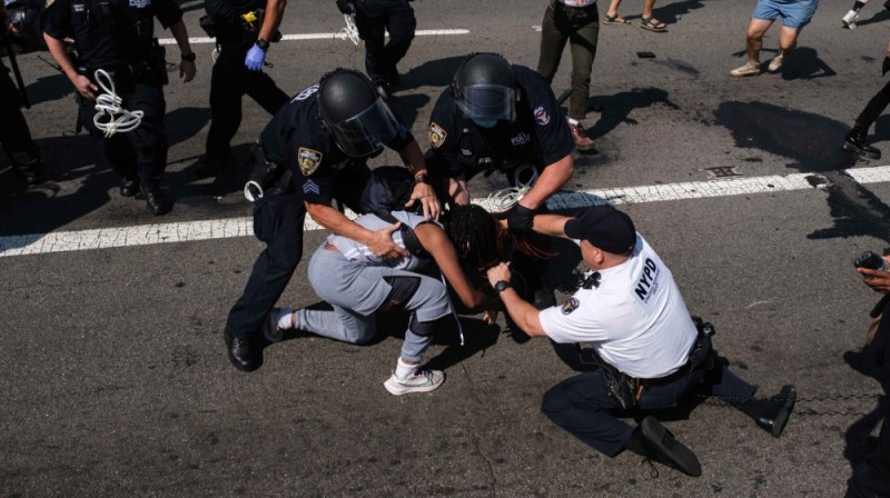 Black Lives Matter protesters are arrested by NYPD officers on the Brooklyn Bridge, Wednesday, July 15, 2020, in New York. Several New York City police officers were attacked and injured Wednesday on