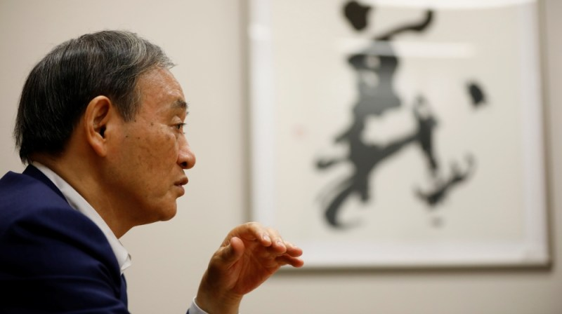 Japan's top government spokesman Chief Cabinet Secretary Yoshihide Suga speaks during an interview with Reuters in Tokyo