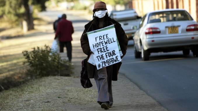 Zimbabwean writer and filmaker Tsitsi Dangarembwa demonstrates outside Hopwell Chin'onos house in Harare, Monday, July 20, 2020. Lawyers say Zimbabwe police have swooped in and detained a prominent j