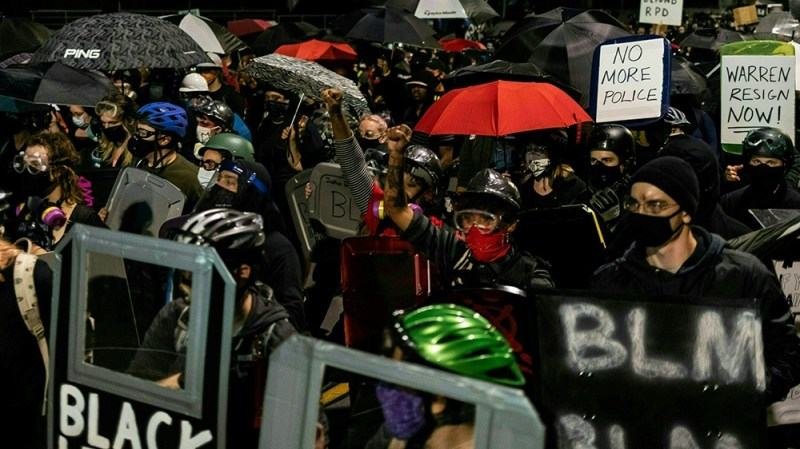 Protesters march for the sixth consecutive night of protest on September 7, 2020, following the release of video evidence that shows the death of Daniel Prude while in the custody of Rochester Police