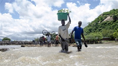 Unprepared and low on supplies, aid organisations rush to reach the thousands of stranded flood victims [EPA]
