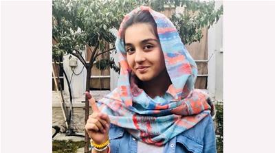 Najmia Popal, 18, a first-time voter [Ali M Latifi/Al Jazeera]