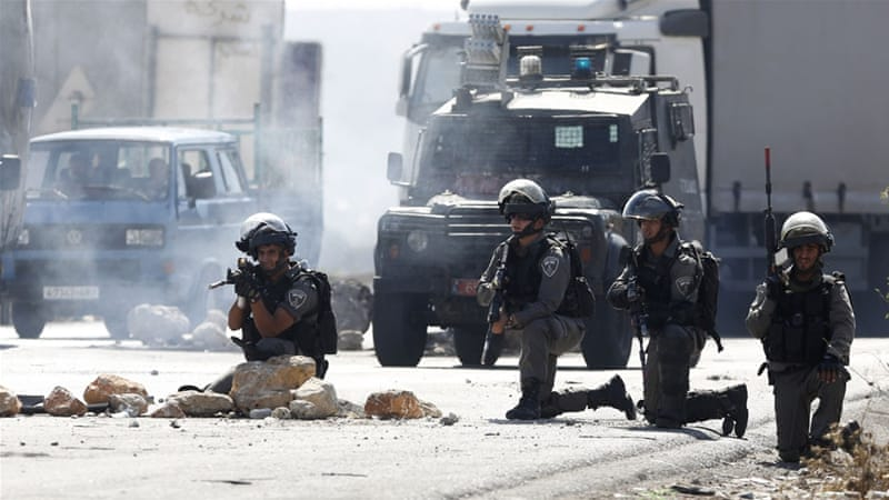 According to the Or Commission of 2000, Israeli police cannot use live fire, including sniper fire, to disperse crowds [AP]