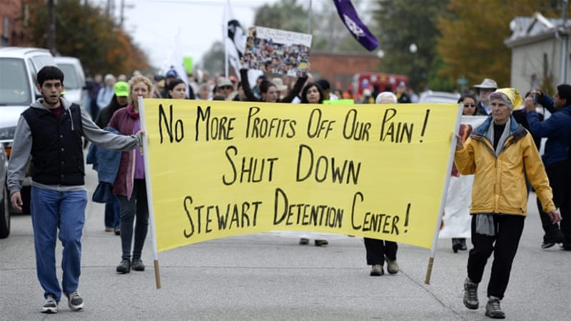Activists approach a detention facility during an immigration rally and march in Lumpkin, Georgia [EPA]