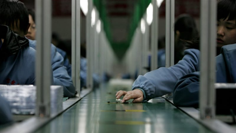 Workers assemble mobile phones on a product line at a factory in Sichuan Province, China [Getty]