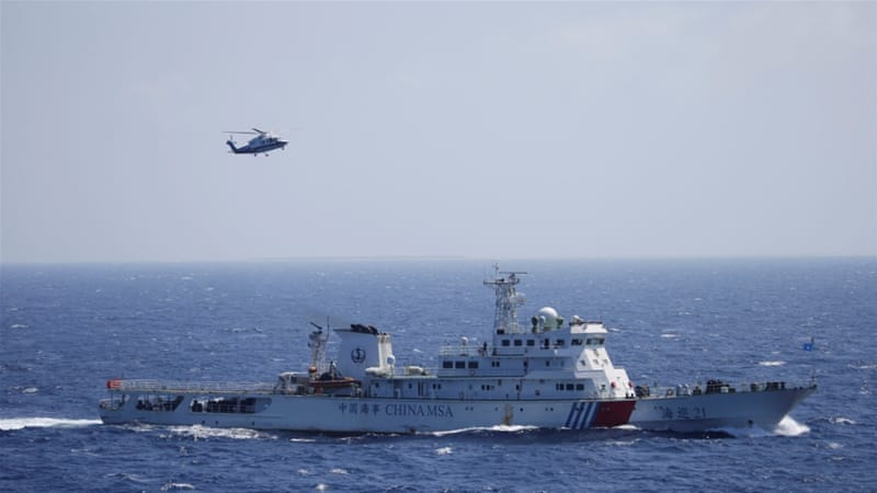 A Chinese ship and helicopter are seen during a search-and-rescue exercise in the South China Sea [Reuters]
