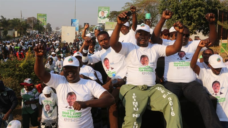 Supporters of Edgar Lungu celebrate after he narrowly won re-election on Monday [Reuters]