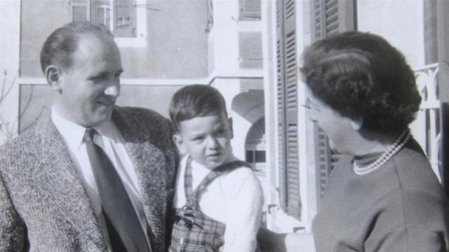 'No one wanted me to know the truth,' said Gil Grunbaum, pictured in the late 1950s with his adoptive parents [Courtesy of Gil Grunbaum]