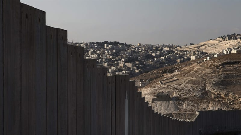 Israel's wall separates families from their land, communities from each other, and often communities from educational, medical and religious services [Finbarr O'Reilly/Reuters]
