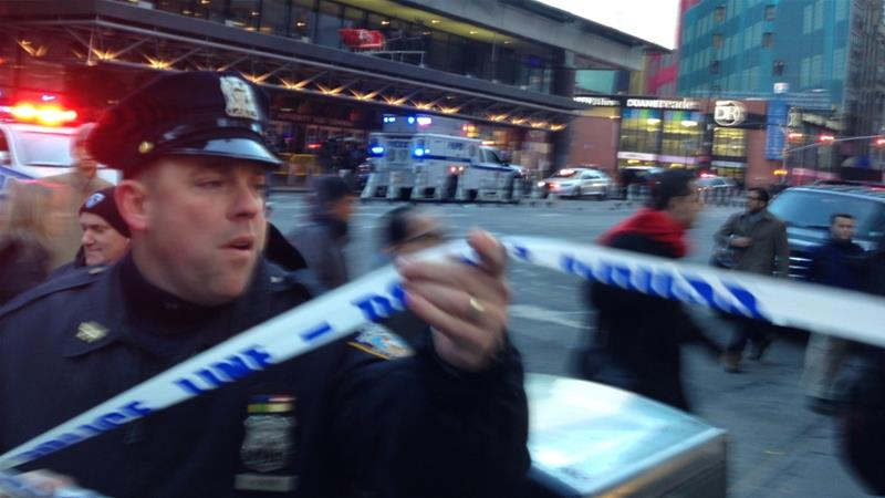 Police respond to a report of an explosion near Times Square [Charles Zoeller/AP Photo]