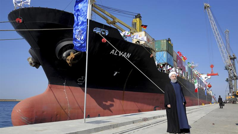 President Hassan Rouhani poses during the inauguration of a newly built extension of the port of Chabahar on Sunday [Ebrahim Noroozi/AP]
