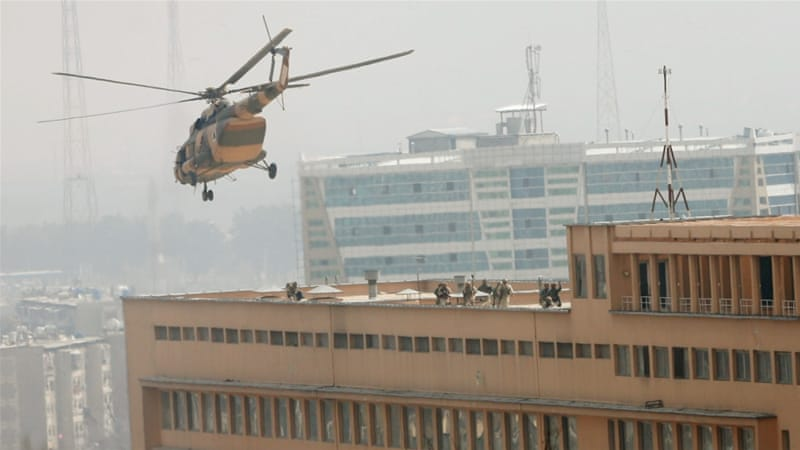 Afghan National Army soldiers descend from a helicopter on a roof of the military hospital [Mohammad Ismail/Reuters]