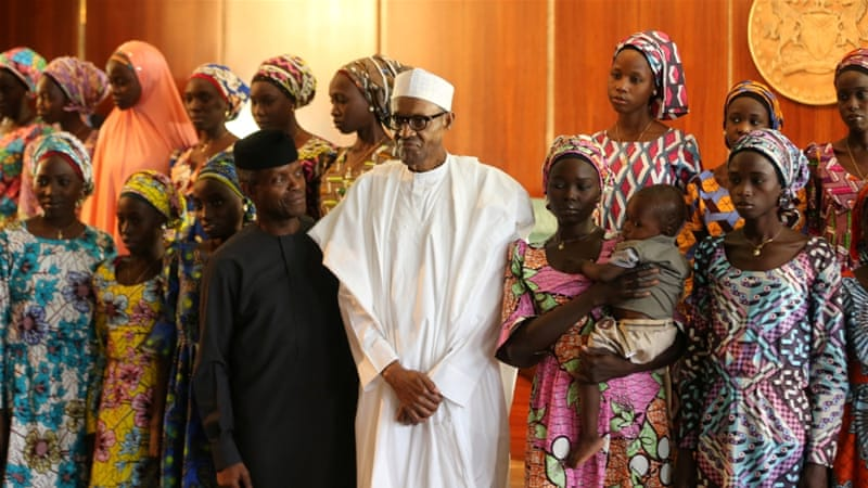 Some of the 21 Chibok schoolgirls released by Boko Haram pose with President Muhammadu Buhari and Vice President Yemi Osinbajo in Abuja, Nigeria October, 2016 [Afolabi Sotunde/Reuters]