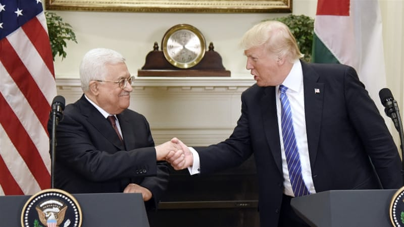 US President Donald Trump shakes hands with the President of the Palestinian Authority, Mahmoud Abbas, after a joint statement  at the White House on May 3 [EPA/Olivier Douliery]