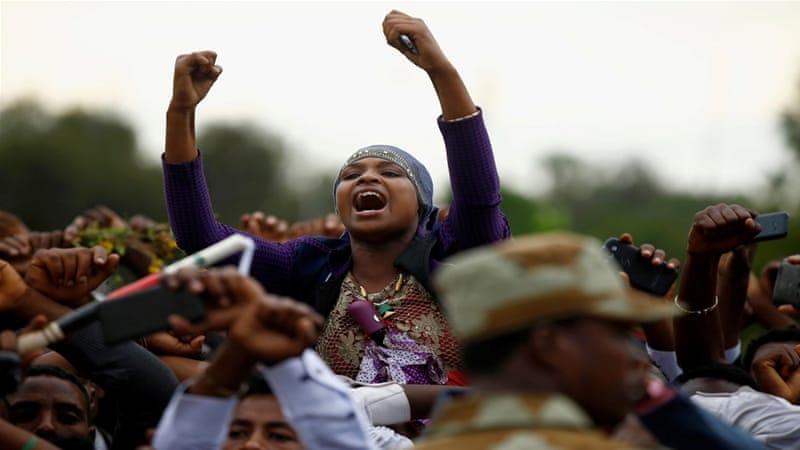 Demonstrators chant slogans while flashing the Oromo protest gesture during Irreecha, the thanksgiving festival of the Oromo people, in Bishoftu town, Oromia region, Ethiopia [Tiksa Negeri/Reuters]