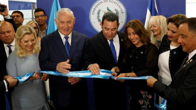 Hilda Patricia Marroquin, the wife of Guatemalan President Jimmy Morales, cuts the ribbon during ceremony of the embassy of Guatemala in Jerusalem [Ronen Zvulun/Reuters]