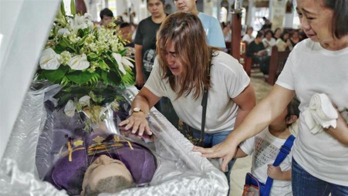 Nilo was preparing for a church service on Sunday when he was killed by unidentified gunmen [Ezra Acayan/Al Jazeera]