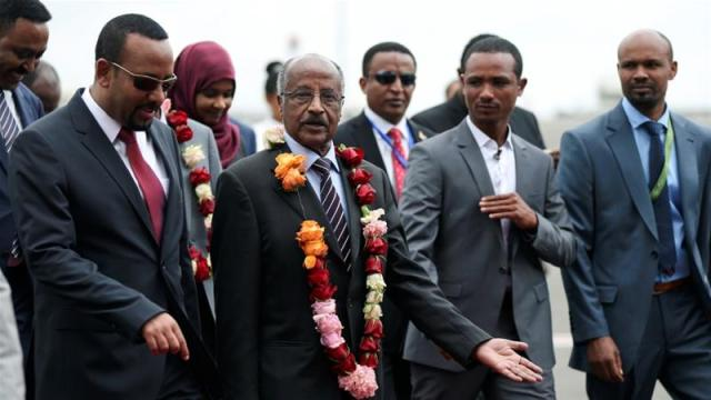 Ethiopia's Prime Minister Abiy Ahmed welcomes Eritrean Foreign Minister Osman Saleh at the Bole International Airport in Addis Ababa, Ethiopia on June 26, 2018 [Tiksa Negeri/Reuters]