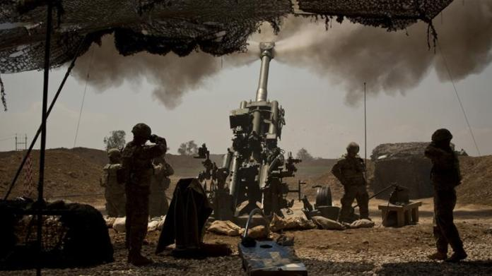 In this file photo from April 17, 2017, US soldiers from the 82nd Airborne Division fire artillery in support of Iraqi forces fighting ISIL from their base east of Mosul [File: Maya Alleruzzo/AP Photo]