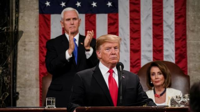 President Donald Trump delivered the State of the Union address, with Vice President Mike Pence and Speaker of the House Nancy Pelosi, at the Capitol [File: Doug Mills/Reuters]