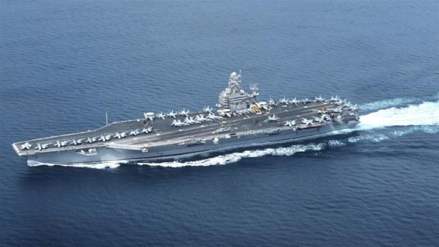 US aircraft carrier USS Abraham Lincoln as it passed through the Strait of Hormuz in February 2012 [Jerine Lee/EPA]
