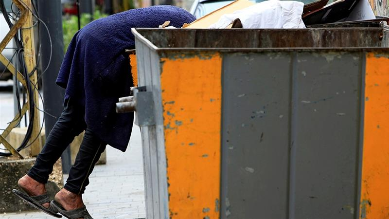 A man searches through a rubbish bin during a countrywide lockdown to combat the spread of coronavirus in Lebanon where millions are at risk of going hungry [File: Ali Hashisho/Reuters]