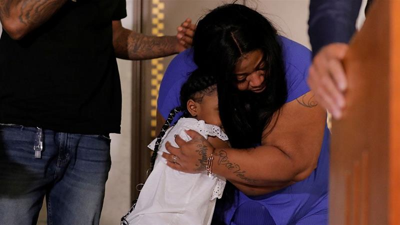 George Floyd's six-year-old daughter Gianna, is embraced by her mother, Roxie Washington [Lucas Jackson/Reuters]