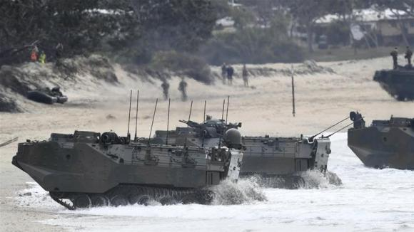 Japanese Assault Amphibious Vehicles come ashore during a joint exercise between the Australian Defence Force and the United States Armed forces in Bowen, Australia [File: Ian Hitchcock/Getty Images]