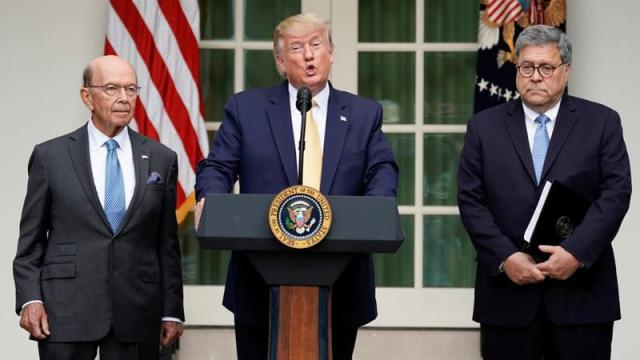 US President Donald Trump stands between Commerce Secretary Wilbur Ross and Attorney General Bill Barr to announce his administration's effort to gain citizenship data during the 2020 census [File:Kevin Lamarque/Reuters]
