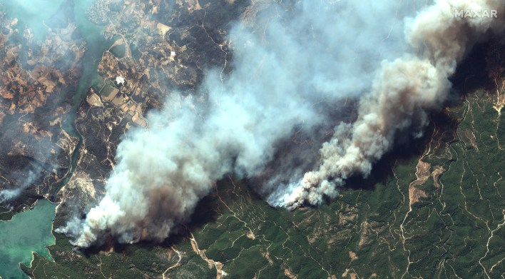 An overview of the wildfires near Oymapinar. [Handout/Maxar Technologies via Reuters]