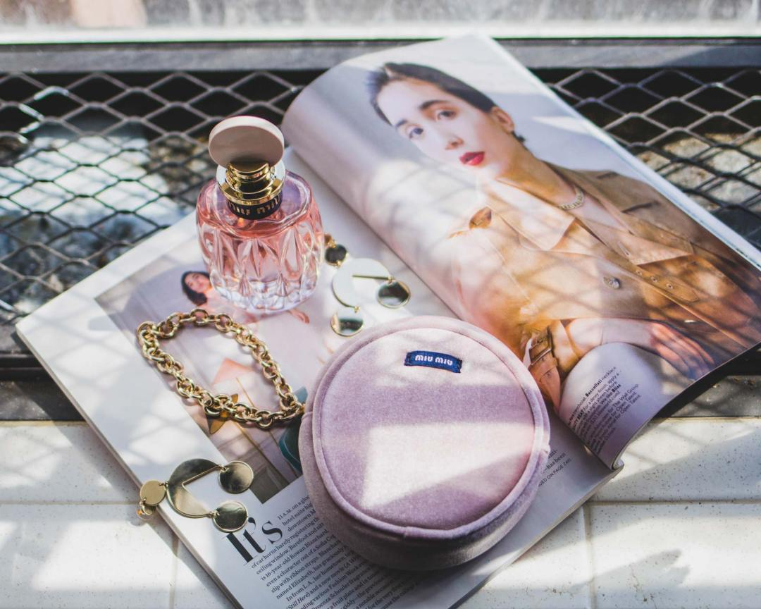 Mother's-day-gift-ideas-miu miu perfum and pouch on a magazine